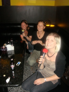 Poppy singing KTV with our friends from the hostel