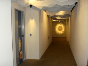 Cool hallway ceiling panels and lighting.