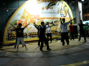 Boys dancing in front of a mall